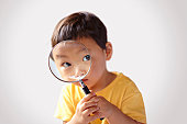 Children looking into a magnifying glass